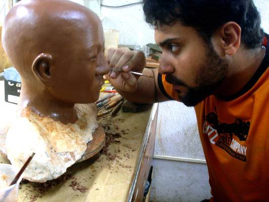 Sculping a chinese boy.