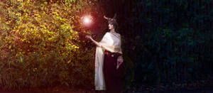 Fantasy Goddess spellcasts light in darkness