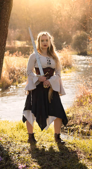 Warrior woman in front of a river