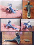 Tiny feathered blue therapod (Sculpey)