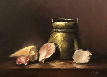 Sea shells and brass bucket