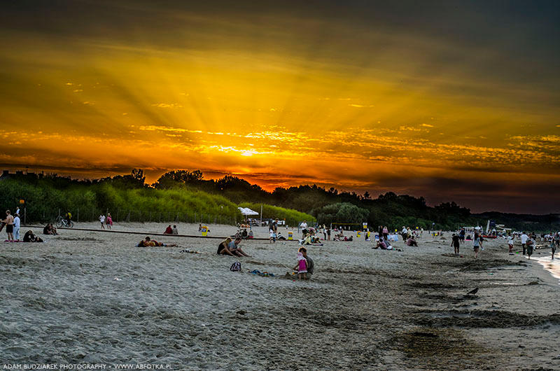 Sunset on the crowded beach