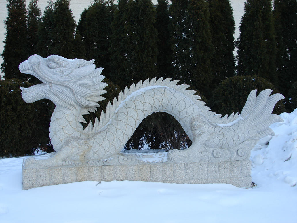 Oriental Dragon Statue in Snow by FantasyStock