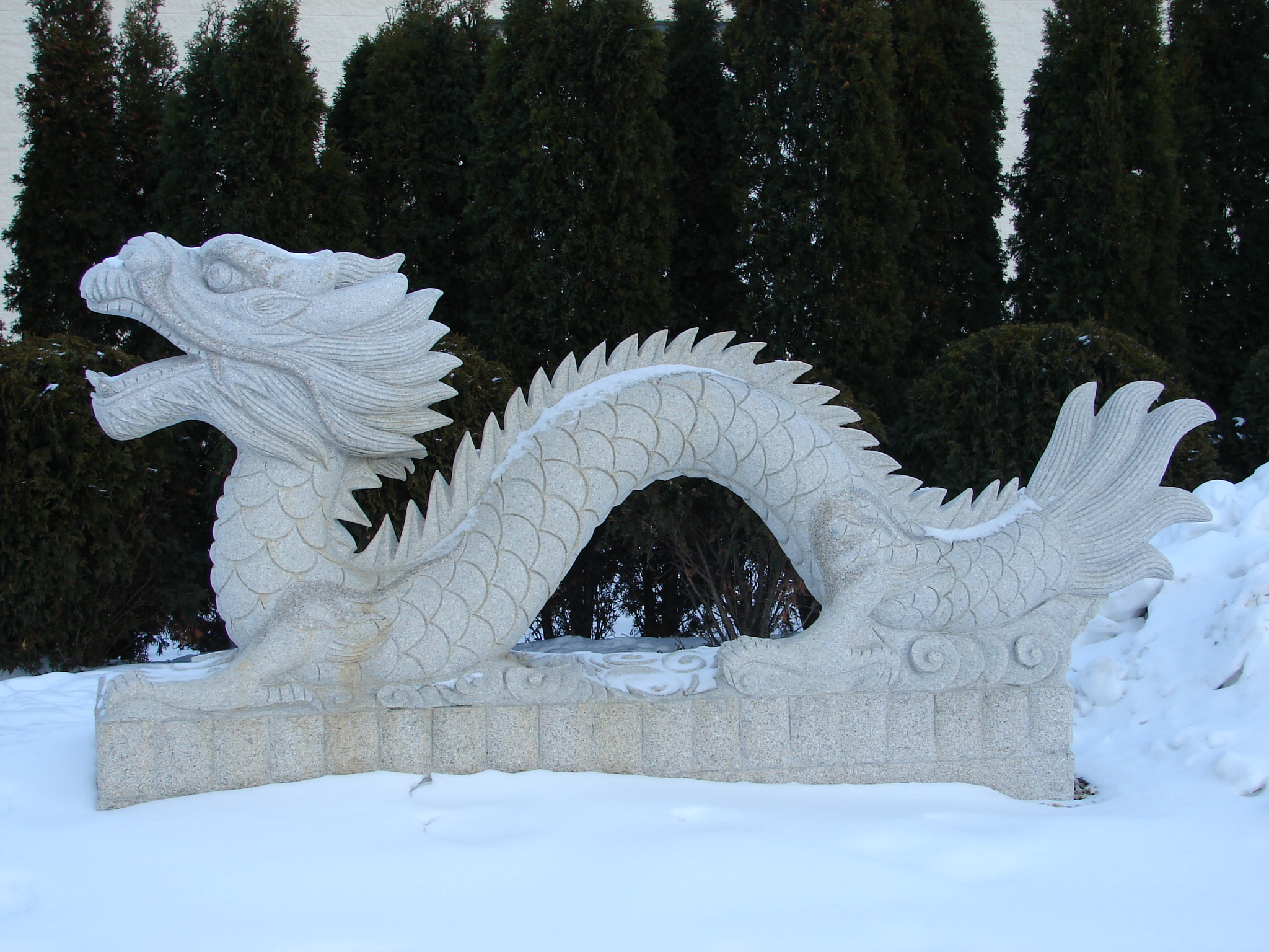 Oriental Dragon Statue in Snow by FantasyStock