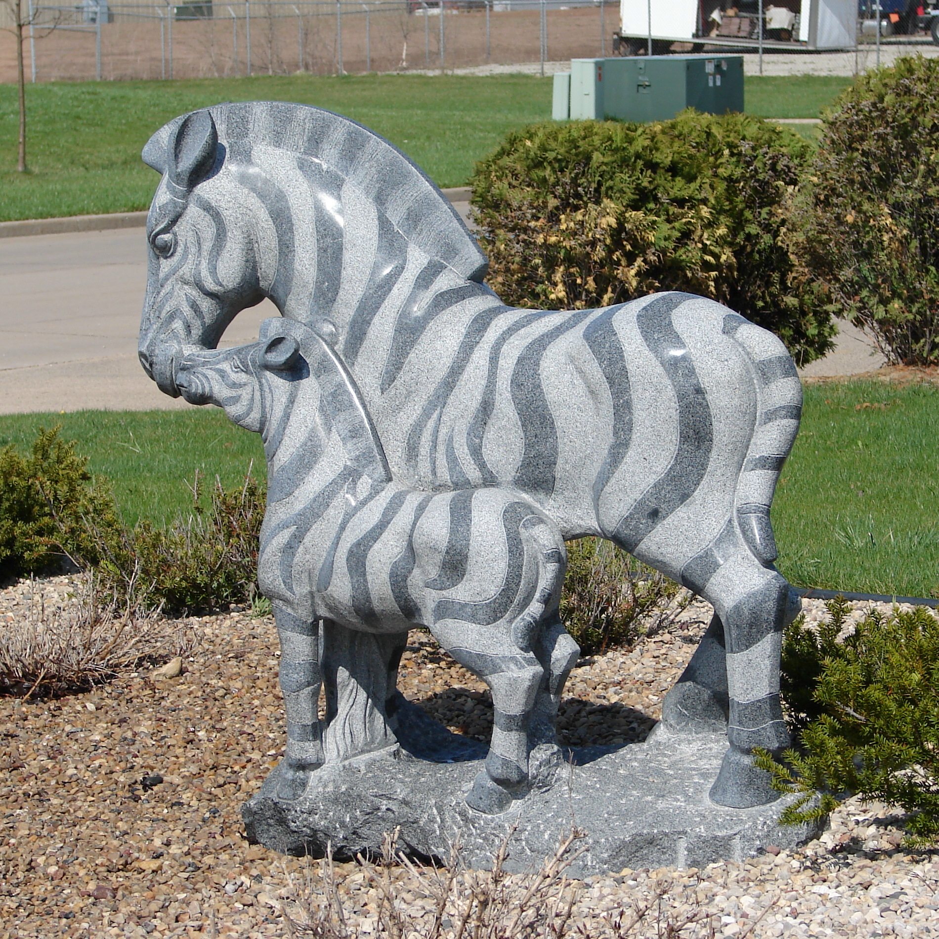 Stone Zebra Statue with Baby by FantasyStock