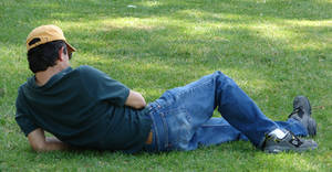 A Guy Reclining at the Park