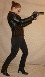 Jodi Standing Aim Handgun Pose by FantasyStock