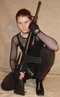 Jodi Crouched Holding Firearm by FantasyStock