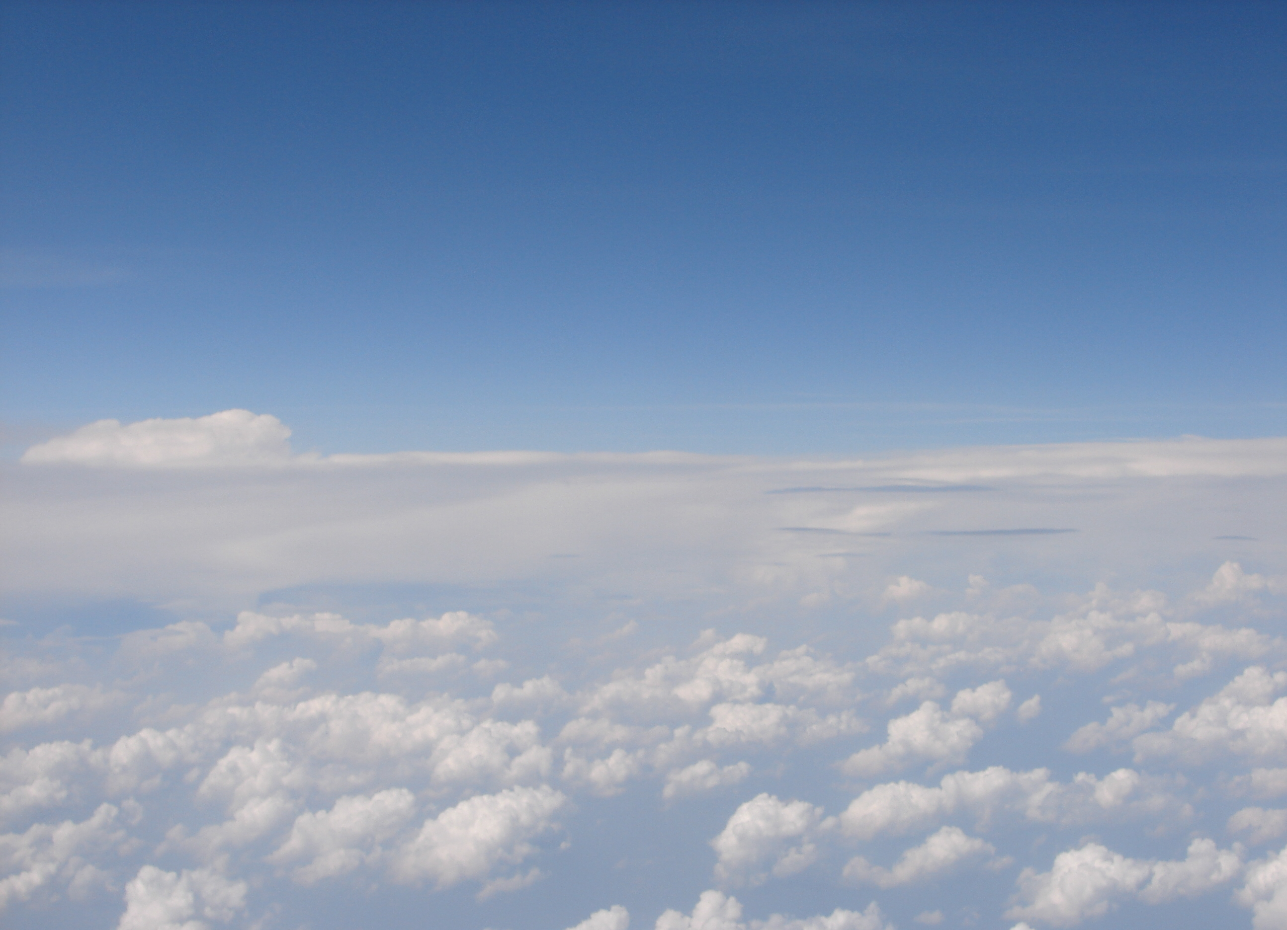 Airplane Above Puffy Clouds 08 by FantasyStock