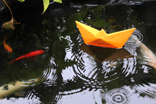 Origami boat on the water