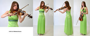 Beautiful young woman with viola Stock