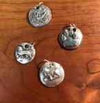 Silver pendants.