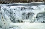 A Small, Frozen Waterfall in a Creek