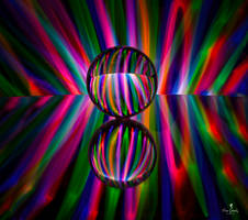 Light Painting Through a Glass Ball on a Mirror