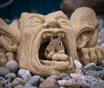 A Chipmunk in the Mouth of a Gargoyle Statue by Nini1965