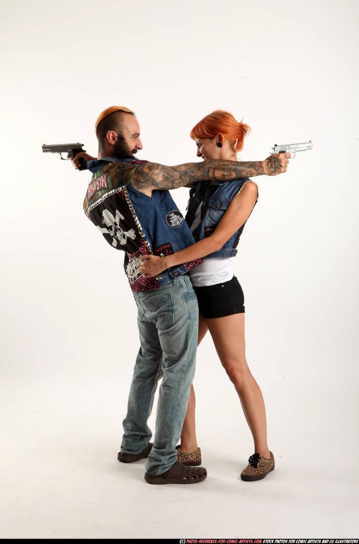 Couple - Cross shooting (pistols)
