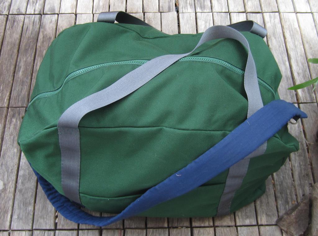 Green suitcase by starbuckwhalerider