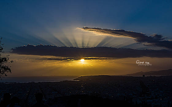 Sunrays pierce the clouds before darkness