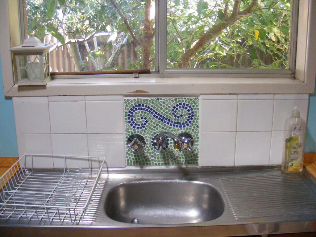 Mosaic and new tapware by Toradellin-Reserve
