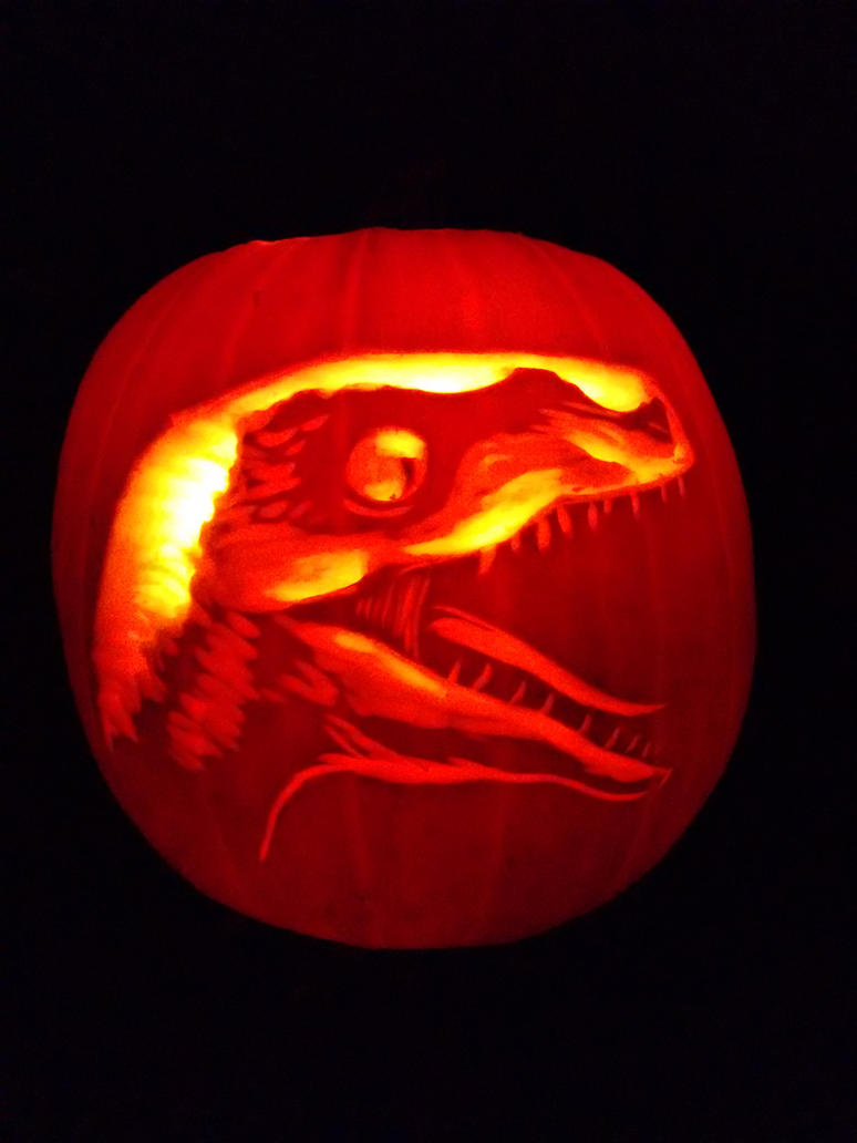 Velociraptor pumpkin by feathergills