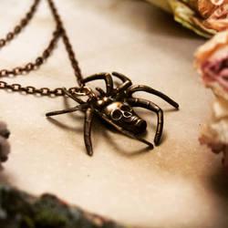 Skull spider pendant by Curionomicon