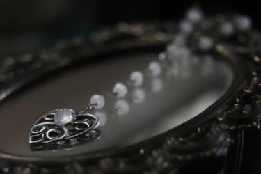Victorian Ouija planchette necklace by Curionomicon