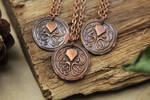 Copper Cthulhu pendants by Curionomicon