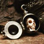 Mini skull curio pendant by Curionomicon