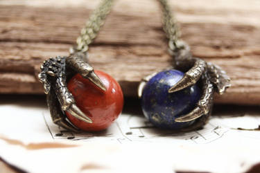 Dragon claw pendants by Curionomicon
