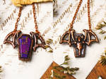 Reversible vampire bat necklace by Curionomicon