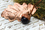 Copper oak leaf and amethyst acorn by Curionomicon