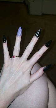 Purple and black stilettos.