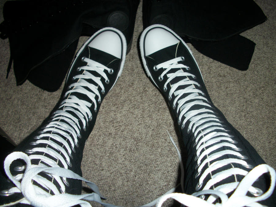 I saw one guy  teenager  Knee High Converse Sneakers