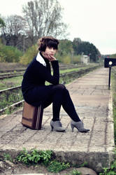 Lady at the train station III by mmagni