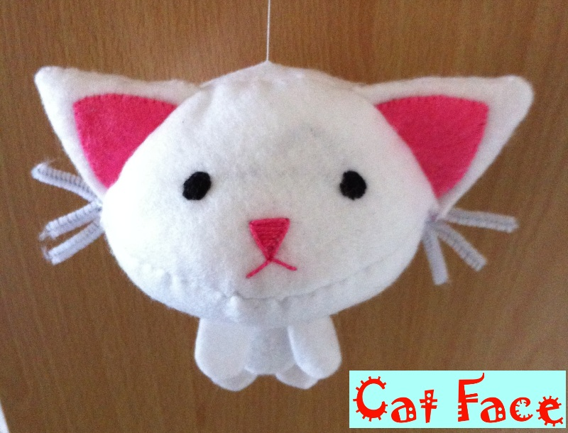 Cat Face Plushie by TombRaiderKuchen