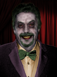 Tim Curry as the Joker
