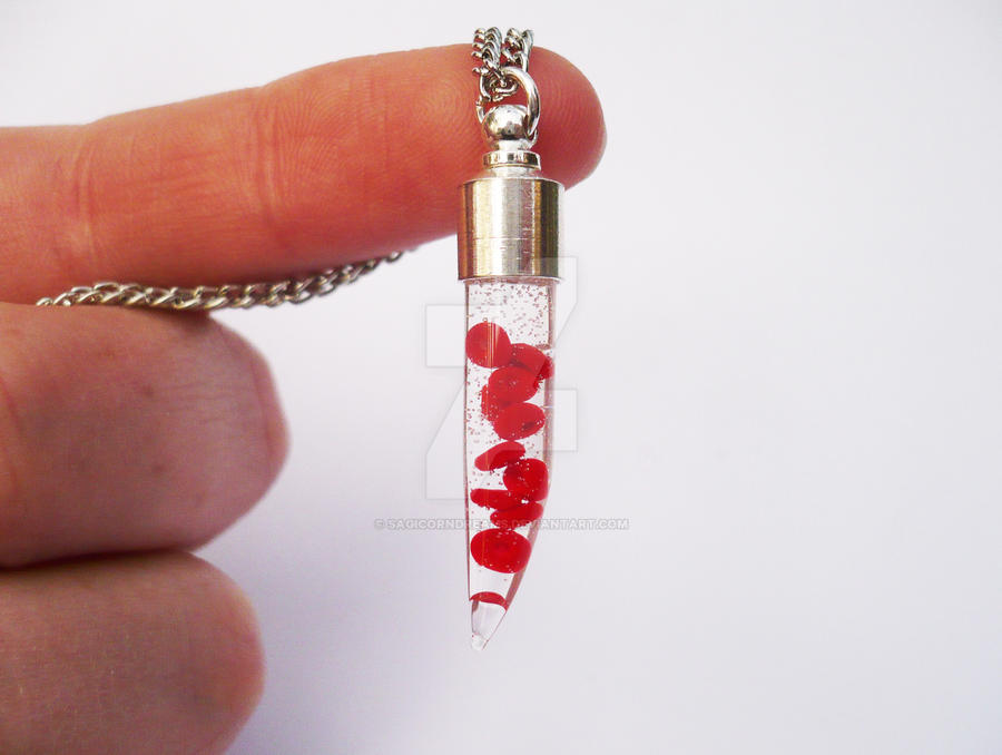 Red Blood Cells Fang Necklace by sagicornDreams