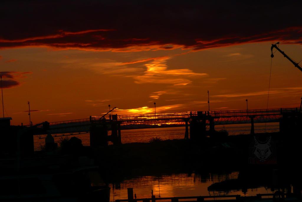 Bridge Over Sunset Waters by wolfwings1