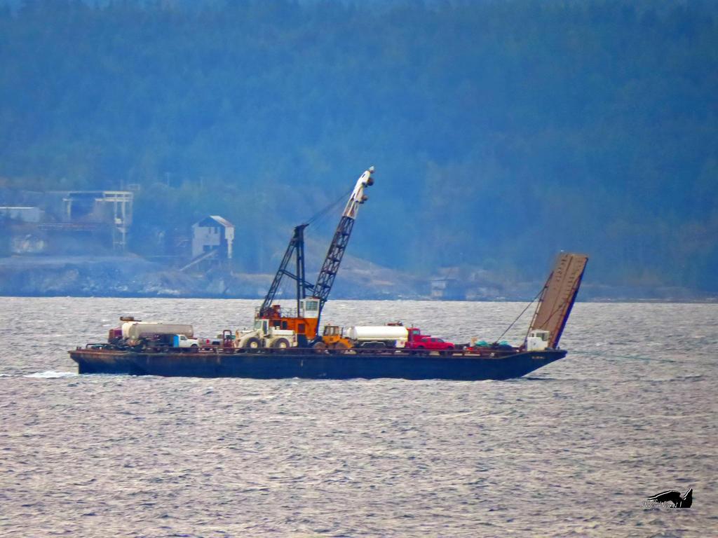 Cargo Boat In Transit by wolfwings1