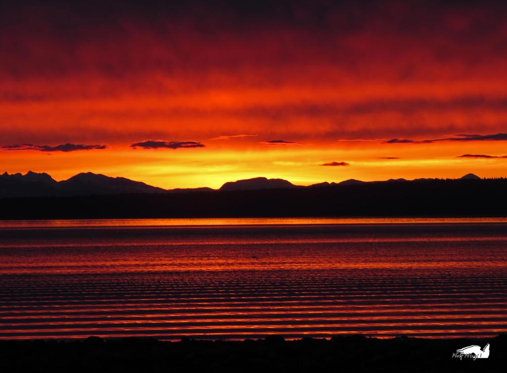 Stratified Sunset Waters by wolfwings1