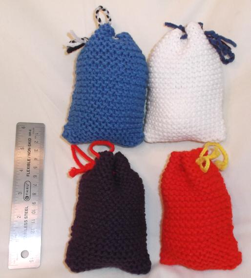 Knitting Pattern Small Drawstring Bag : Small drawstring knit bags by mew-trainer-rose on DeviantArt
