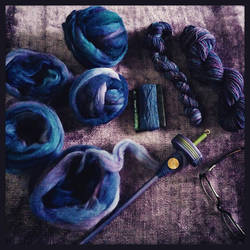 Various stages of the purpley blue yarn