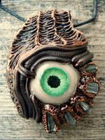 Biomech tourmaline eyeball pendant by dogzillalives