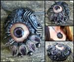 Amethyst biomech eyeball pendant