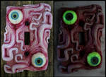 Glow in the dark eyes and tentacles switch plate