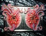 Framed tentacle beasts sculpture