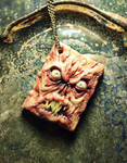 Miniature book of the dead pendant