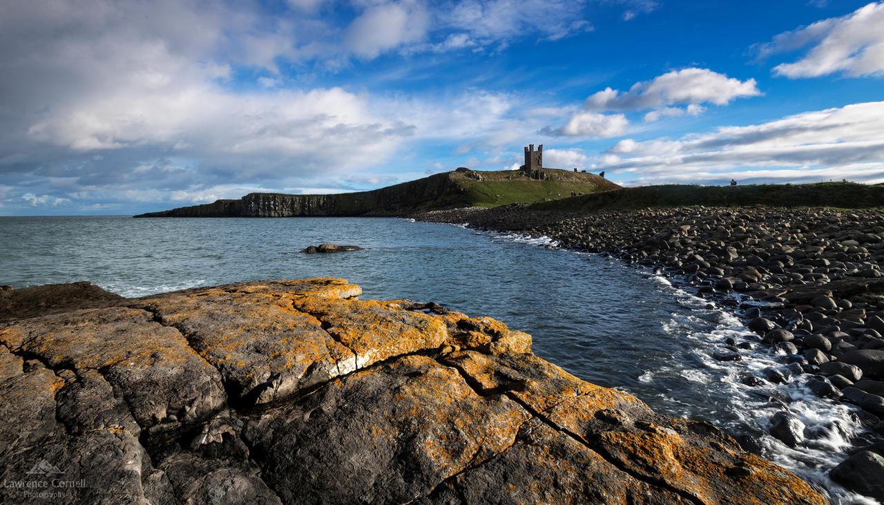 Dunstanburgh dominates by LordLJCornellPhotos