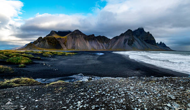Rising from the black sand.
