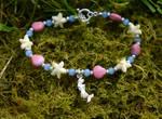 Shells, starfish, and mermaid bracelet by FeynaSkydancer